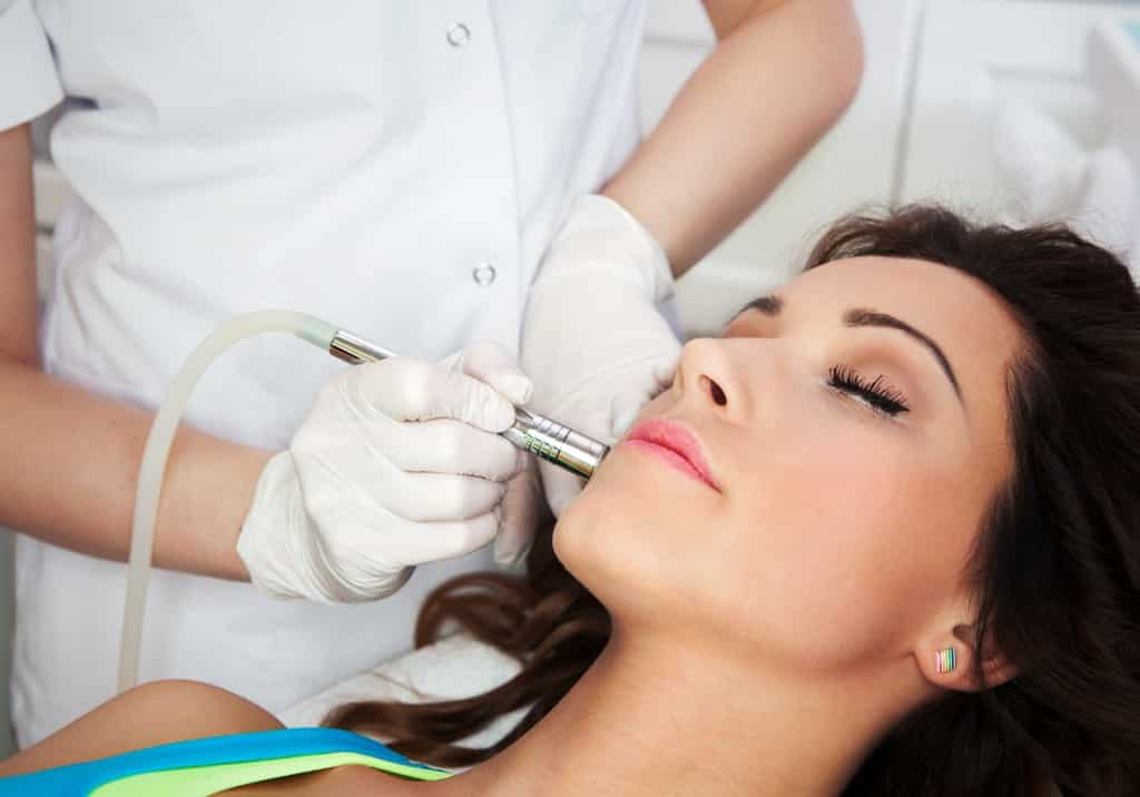 Close-up of a woman receiving a professional skin treatment service