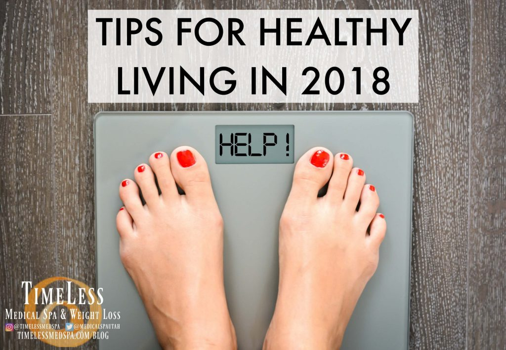 """Body weighing scale that reads HELP with text """"Tips for Healthy Living in 2018"""""""