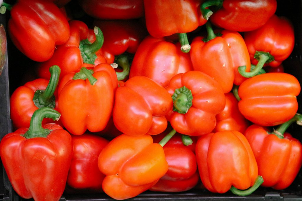 Close-up of a pile of fresh red bell peppers